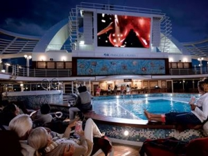 Watch a movie while winding down by the pool side